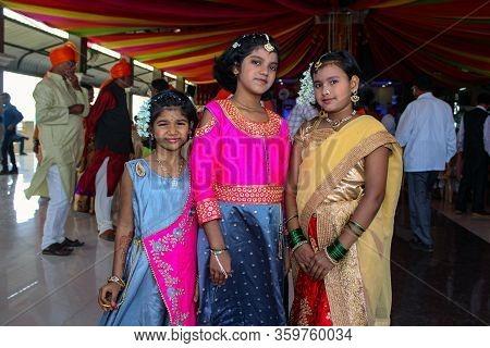Kolhapur, Maharashtra/ India- December 12th 2019; 3 Little Girl Wearing Traditional Dresses At Weddi