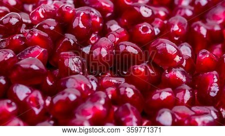Texture Of Red Ripe Pomegranate Seeds Closeup