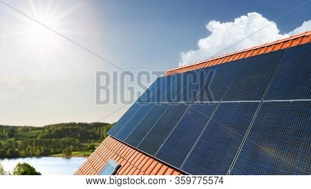 Solar Energy Panels At The Rooftop On A Sunny Day With Copy Space