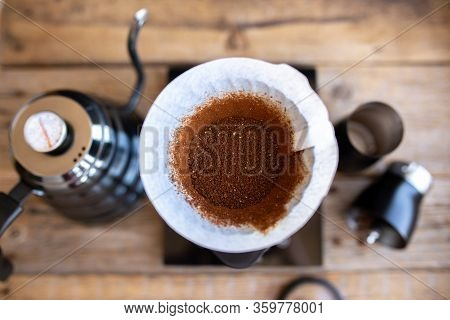 Ground Coffee Beans In A Funnel. Coffee Brewing Ritual. Making Coffee At Home. Filtered Coffee, Or O