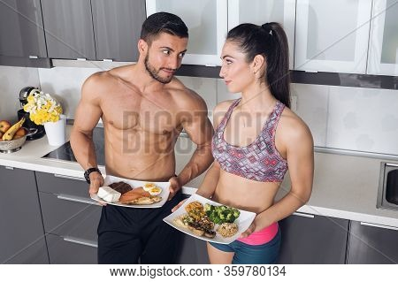 Fit Couple In The Kitchen; Animal Versus Plant Proteins: One Plate With Beef, Eggs, Salmon, Cheese A