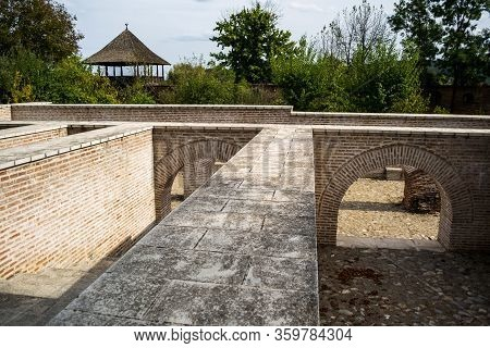 Underground Building With Stairs And An Archway. Strehaia Monastery. Romania