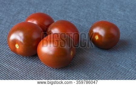 Fresh Cherry Tomatoes On A Background, Cherry Tomatoes On Gray Fone