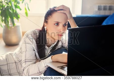 Upset, Sad Woman Is Sitting At Computer. Job Search, Crisis, Unstable Situation.unemployed Jobless P