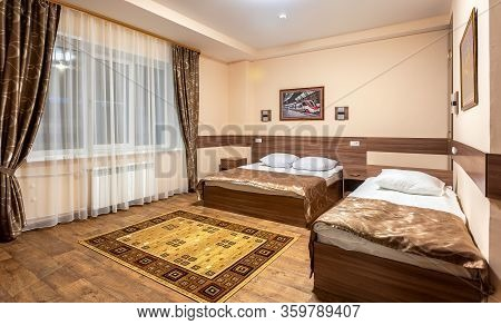 Moscow, Russia - July 6, 2019: Modern Bedroom Suite In Hotel With Two Beds And Carpet On The Floor