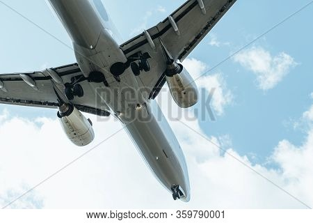 Front Of A Commercial Plane Flying Seen From Below, Travel Concept, Copy Space For Text