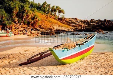 Untouched Tropical Beach With Palms And Fishing Boat In Sri-lanka. View Before Sunset