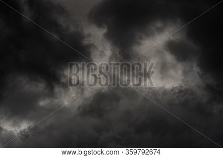 Dramatic Thunderstorm Clouds In Dusk Sky During Rain. Natural Cloudiness Weather Background. Blurred