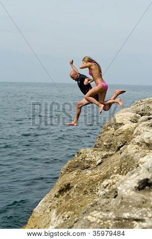 People Jump Off A Cliff