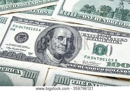 One Hundred Dollars. Portrait Of President Benjamin Franklin. Us Dollars Background. Closeup Of A Lo