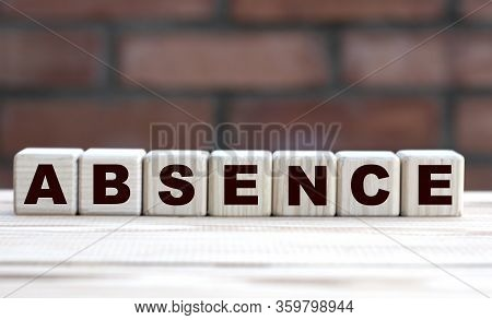 Concept Word Absence On Cubes Against The Background Of A Brick Wall