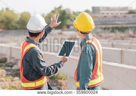 Construction Engineer Standing In A Conversation On The Construction Site