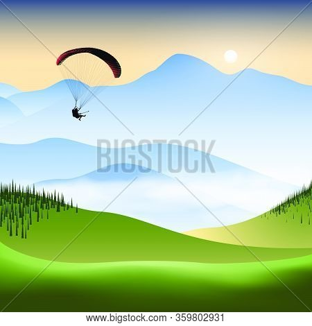Silhouette Of Flying Paraglider Take A Selfie With Action Camera In A Mountain Valley At Sunrise. Ve