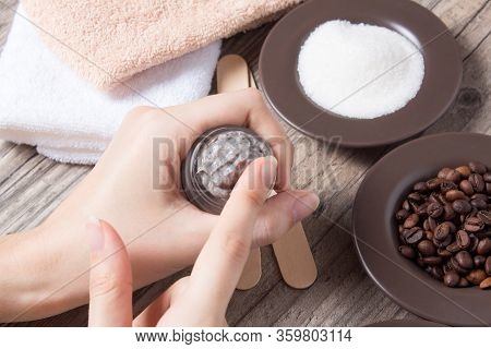 A Woman Applies Of Coffee Homemade Scrub. Spa, Beauty. Ingredients For Making A Scrub, Coffee Beans,