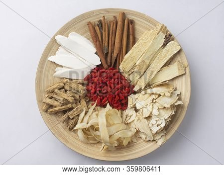 Chinese Medicine Herbs For Herbal Soup On Wooden Dish Isolated On White Background