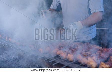Cook Cooks Kebabs On Coals.cook Cooks Kebabs On Coals