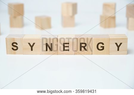 Modern Business Buzzword - Synergy. Word On Wooden Blocks On A White Background. Close Up.