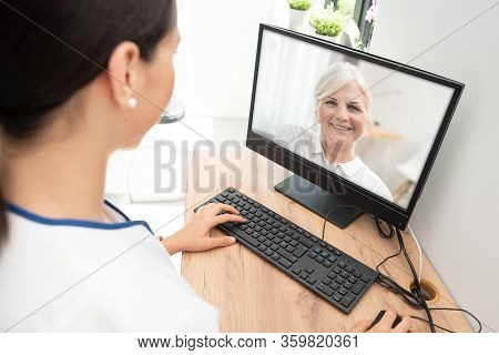 Doctor And Senior Woman Patient Medical Consultation, Telehealth, Telemedicine, Remote Health Care C