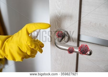 Coronavirus, Covid 19 Protection. Hand Disinfects And Cleans Door Handle With Antibacterial Wet Wipe
