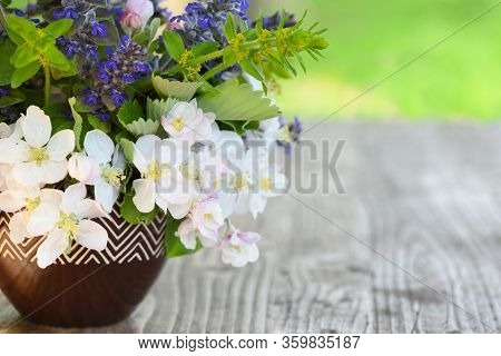 Bouquet Of Spring Flowers On The Wooden Table