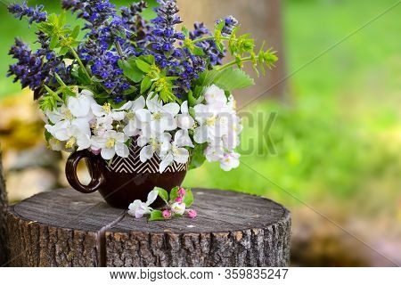 Bouquet Of Spring Flowers On The Natural Background
