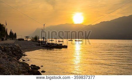 Beautful coastline of Garda lake at sunset, northern Italy