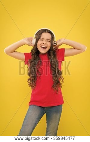 Kid Listening Music Headphones. Music Beat Concept. Entertainment And Fun. Top Summer Songs. Child O