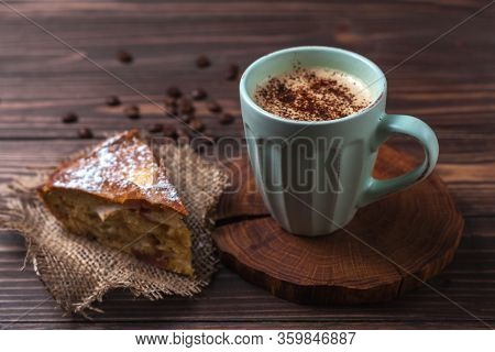 Cup With Coffee And Apple Pie On A Rural Wooden Tabletop. Latte Or Cappuccino With Chocolate Sprinkl