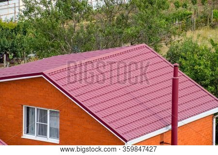 Roof Made Of Metal. Construction With Modern Roofing Materials. Corrugated Metal Profile.