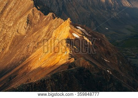 Atmospheric Alpine Landscape With Shiny Rockies With Snow In Golden Hour. Scenic View To Big Orange
