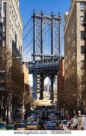 Down Under the Manhattan Bridge Overpass - DUMBO Point from brooklyn New york city NY USA. This is the neighborhood landmark located between manhattan and brookltn bridge in New York City USA.