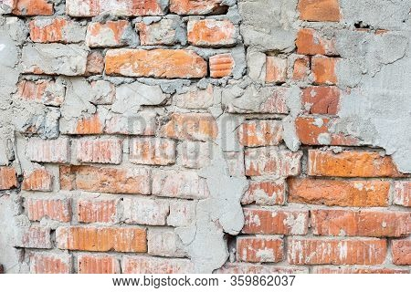 Texture Of An Old Broken Red Brick Wall With Cement Mortar. Clay Brick Background On Broken Wall Wit