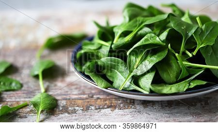 Fresh Baby Spinach On A Plate. Juicy Spinach Leaves. Diet Concept. Vegan Food.