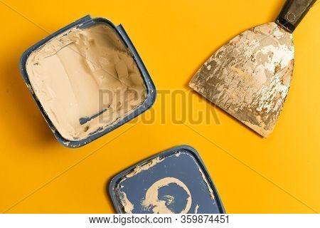 Filler - Wood Filler Or Crack Filler Over Yellow Background