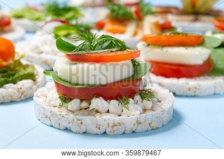 Healthy Food Rice Cake Sandwich On Light Blue Background. Rice Cookies Sandwich On Table With Sandwi