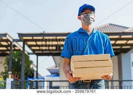 Asian Young Delivery Man Courier Online With Food Order Is Pizza Boxes In Uniform He Protective Face