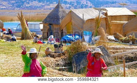 Titicaca Lake Peru, August 16. The Inhabitants Of The Floating Islands Greet The Arrival Of Tourists