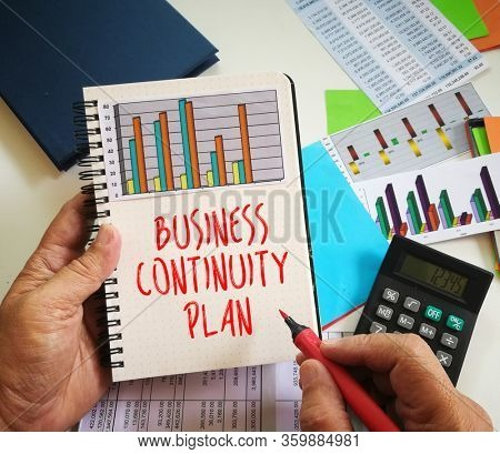 Business continuity plan written on note book