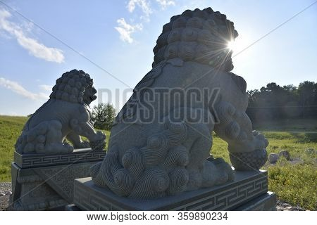 Chinese Guardian Lions  Placed In The Entrance Of The Temple - Back Lit