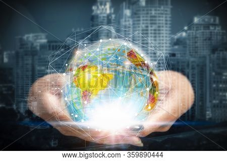 Hand Holding Abstract Illuminated Globe And Connection Lines Symbol With Blurred Business City Cente