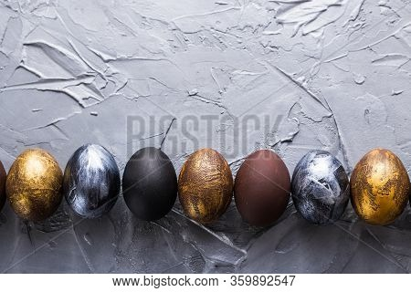 Holidays, Traditions And Easter Concept - Dark Stylish Easter Eggs On Grey Background With Copyspace