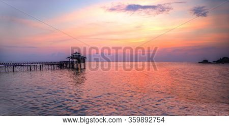 Panorama Of A Romantic Golden Tropical Lagoon Sunset On Bintan Island In Indonesia With Silhouette O