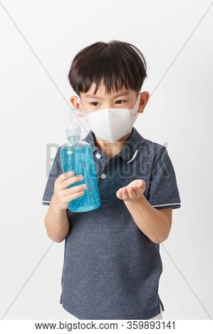 Asian Child Boy Wearing A Protection Mask For Prevent Against Infection Of Covid-19 Virus Outbrea