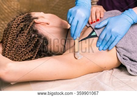 Waxing Woman Armpit. Salon Wax Beautician Epilation Procedure. Waxing Female Body For Hair Removal B