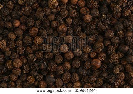 Black Peppercorn Close Up. Macro Texture Of Black Hot Pepper. Macro Background.