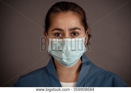 Female Doctor Or Nurse Wearing Protective Face Medical Mask. Save Lives From Covid-19 Outbreak