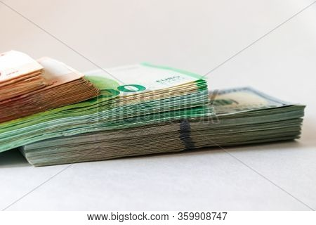 American 100 Dollar Bills Are Folded In The Form Of A House Of Cards. Savings, Planning, Forecasts.