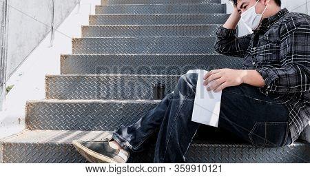 Covid-19 And Unemployment Concept. Resignation And Stressful. Corona Virus Job Losses In Thailand. E