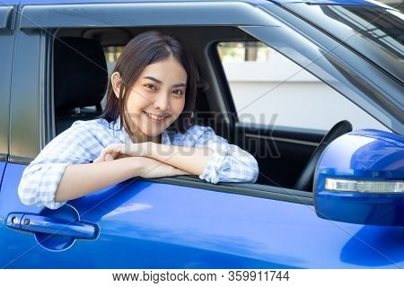 Asian Women Driving A Car And Smile Happily With Glad Positive Expression During The Drive To Travel