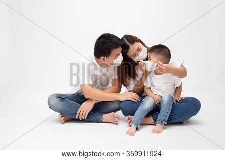 Asian Family Wearing Protective Medical Mask For Prevent Virus Wuhan Covid-19 And Sitting Together O